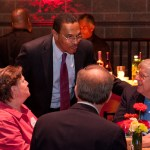 Hrabowski leans down to talk to table at Hilltop Society