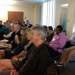 Audience at political science reception