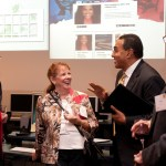 People laugh as they talk with Hrabowski society dinner atendees