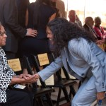 Two women shake hands at Sherman Dedication