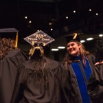 Graduates interact with professors