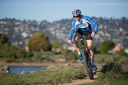 Person rides bike on mountain trail