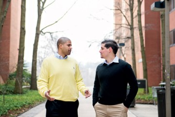two men talking on academic row