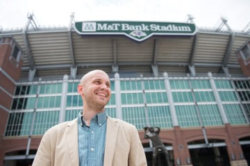 Alex Pyles poses in front of M&T Bank stadium