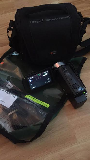 equipment bag with camcorder and other gear