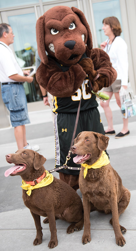 Mascots meet at the Puppy Parade, as True Grit gets a grip on some of the Chesapeak
