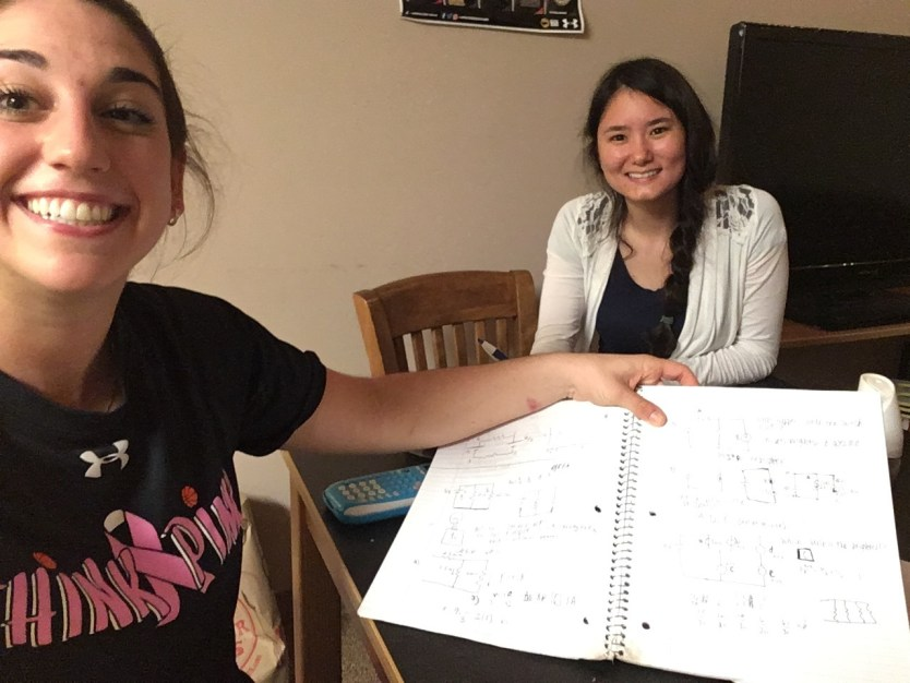 Roommates studying together in apartment
