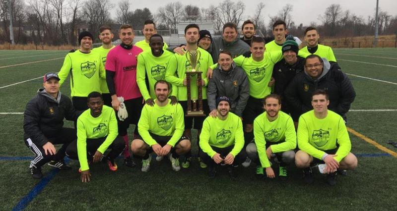 Christos team poses with award