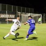 Umbc mens soccer game where ball is between retriever and other team
