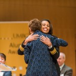 Two women embrace at UMBC Alumni awards