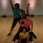 4 performers posing in studio