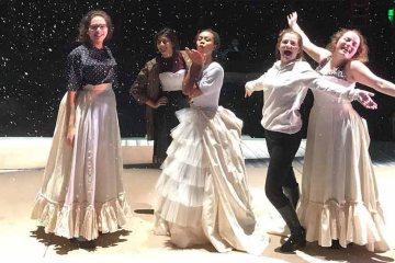 twelfth night actors pose on stage