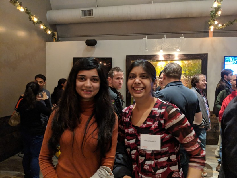 two girls pose together at bay area alumni event