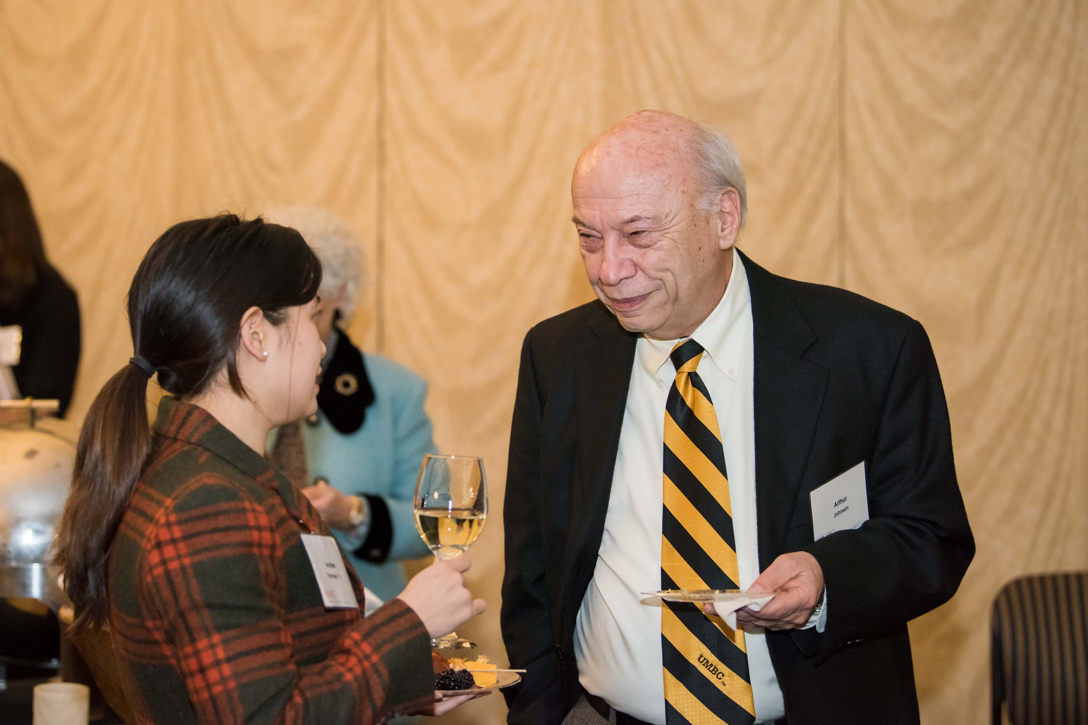 Two people interacting at Annapolis alumni reception