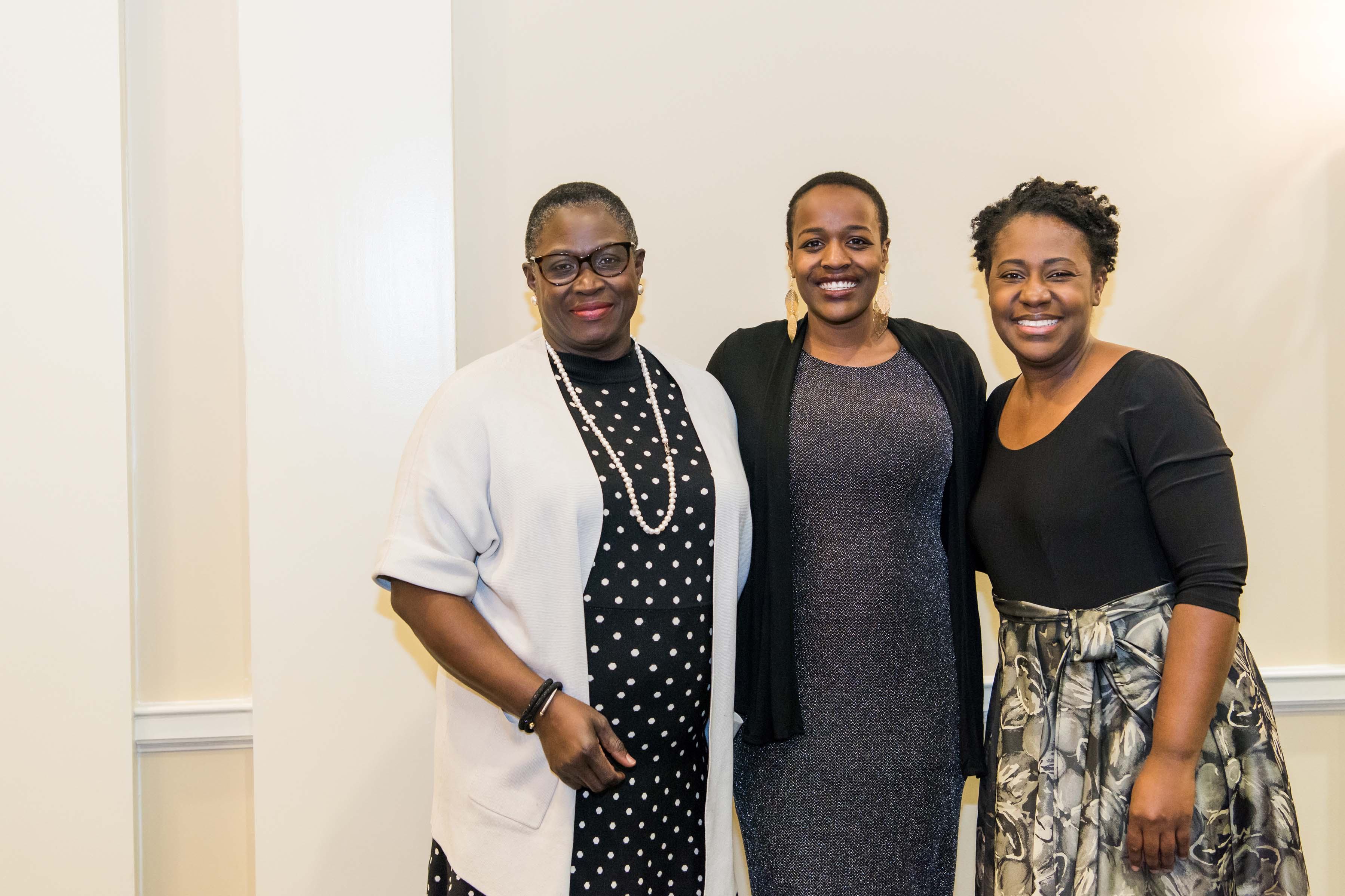 Naomi Mburu poses with two others at Annapolis Alumni reception
