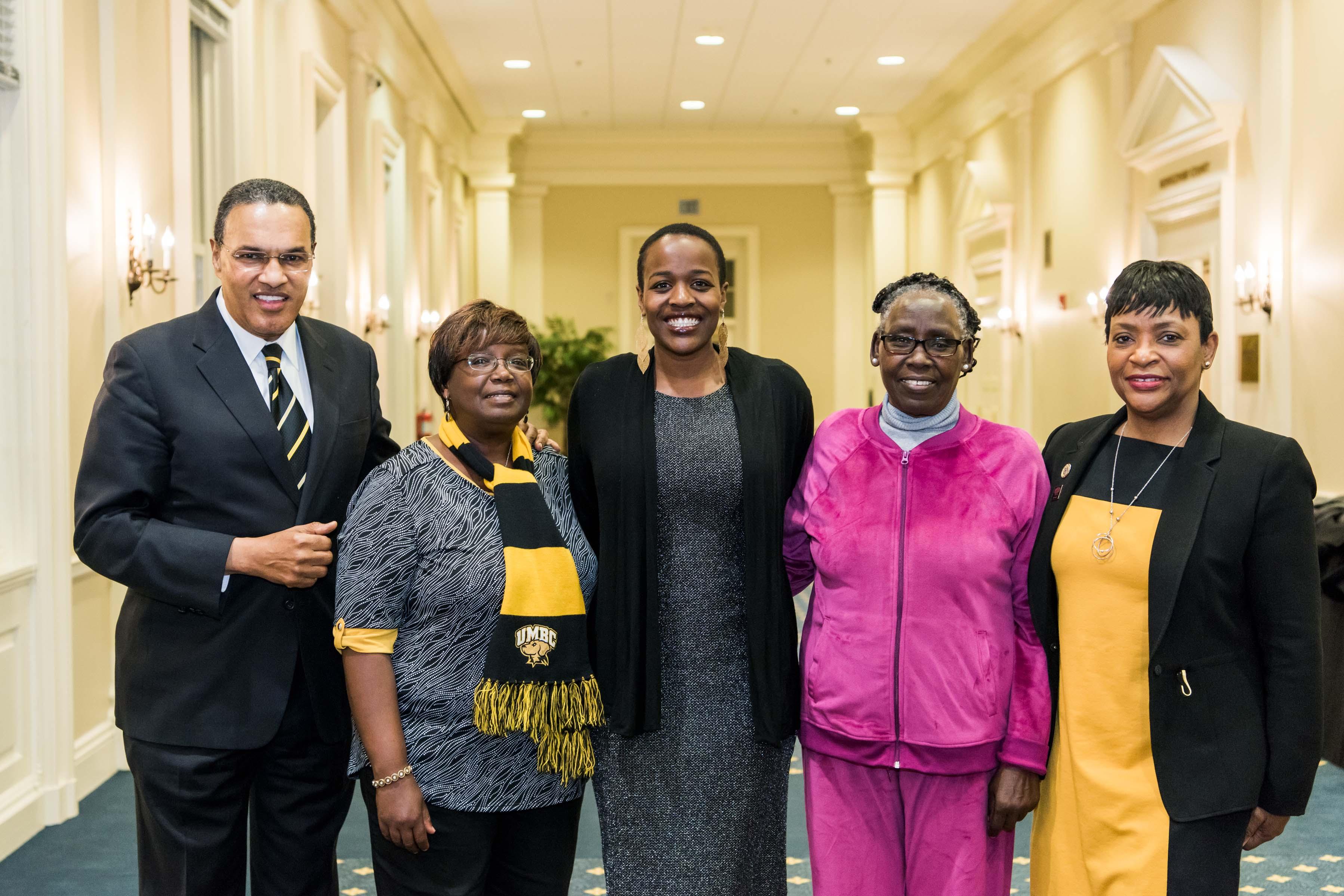 Naomi Mburu, Hrabowski, and others pose toegether at Annapolis Alumni reception