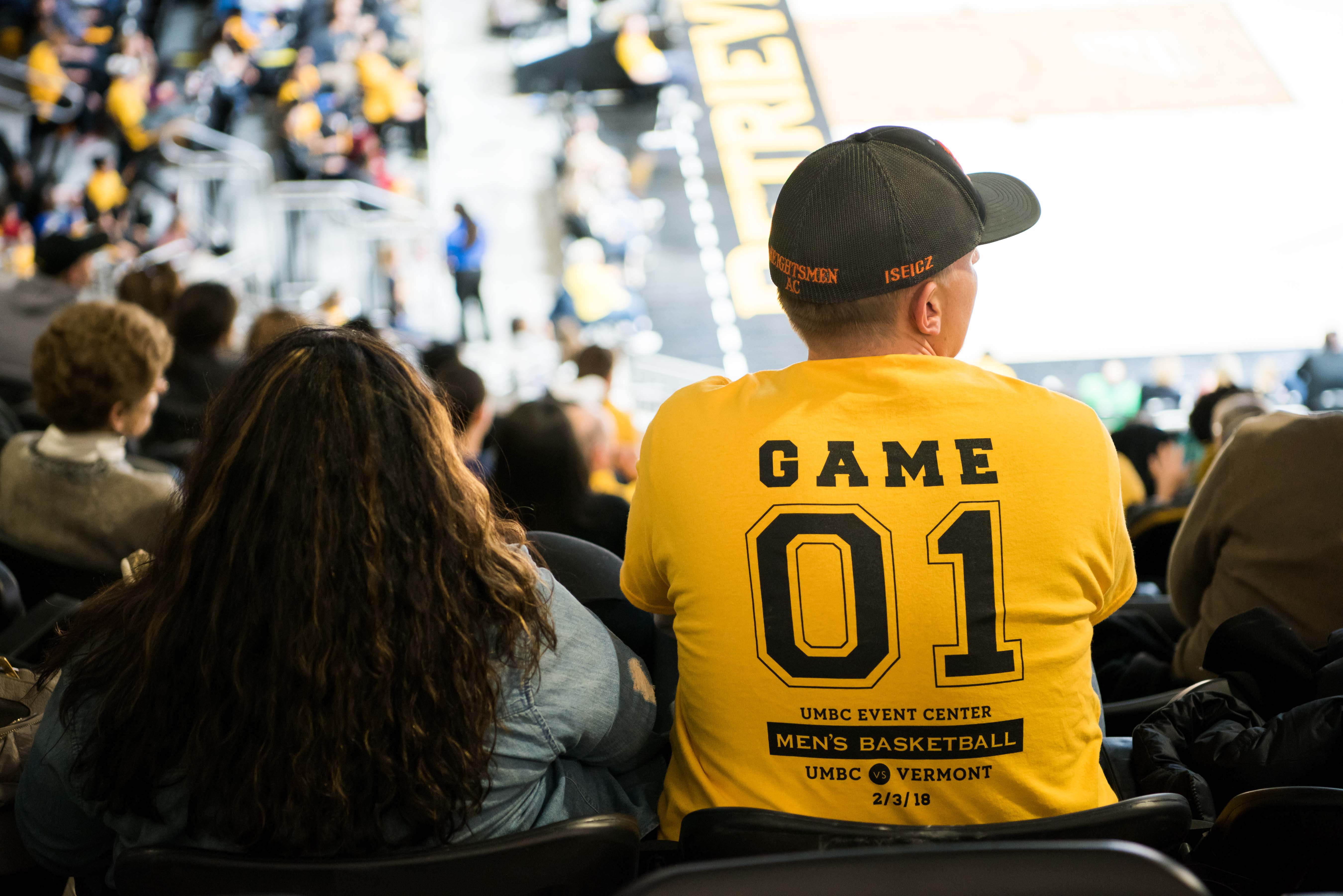 attendee with Game 01 UMBC event center shirt on