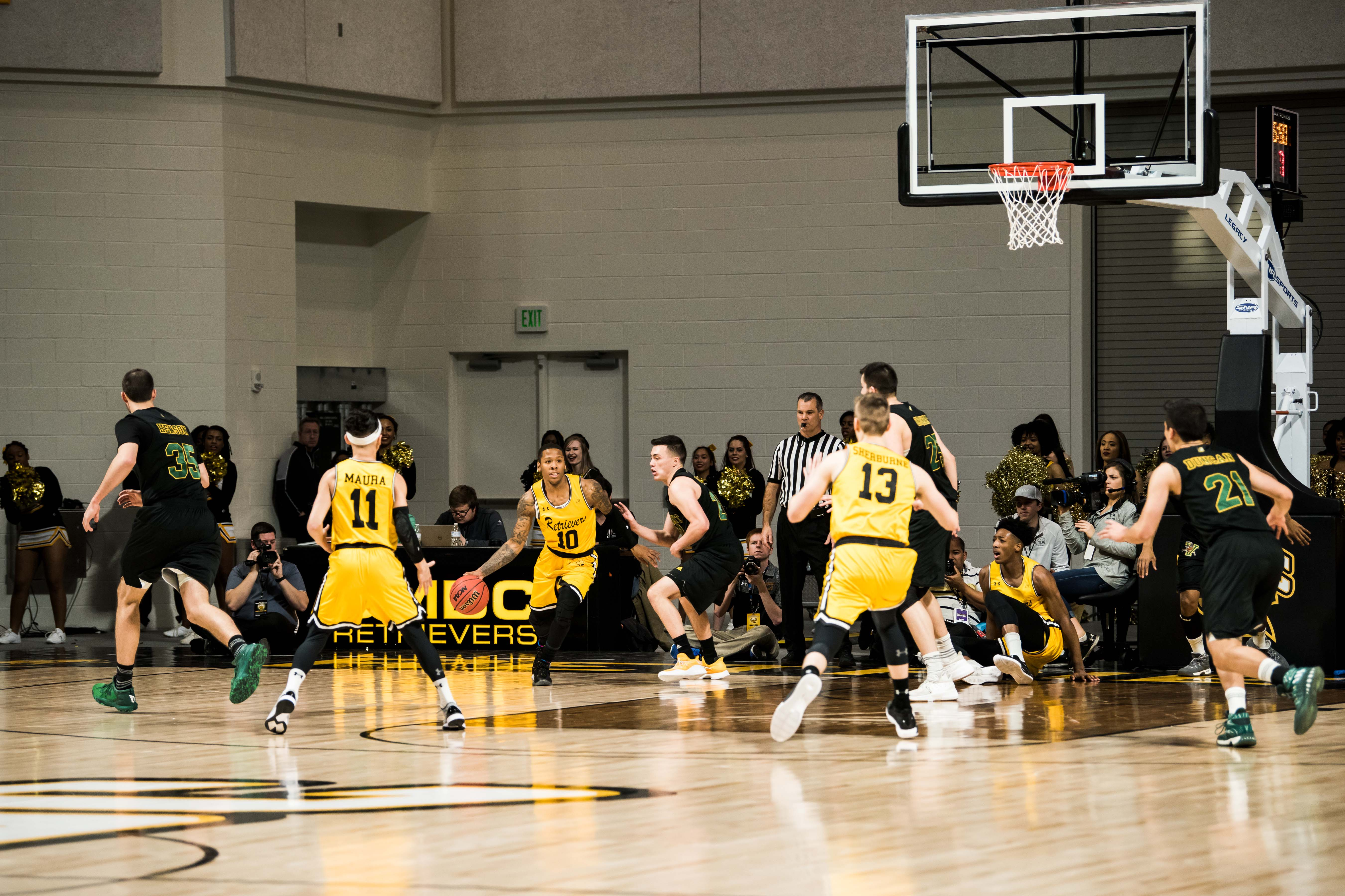 UMBC basketball players play game in event center