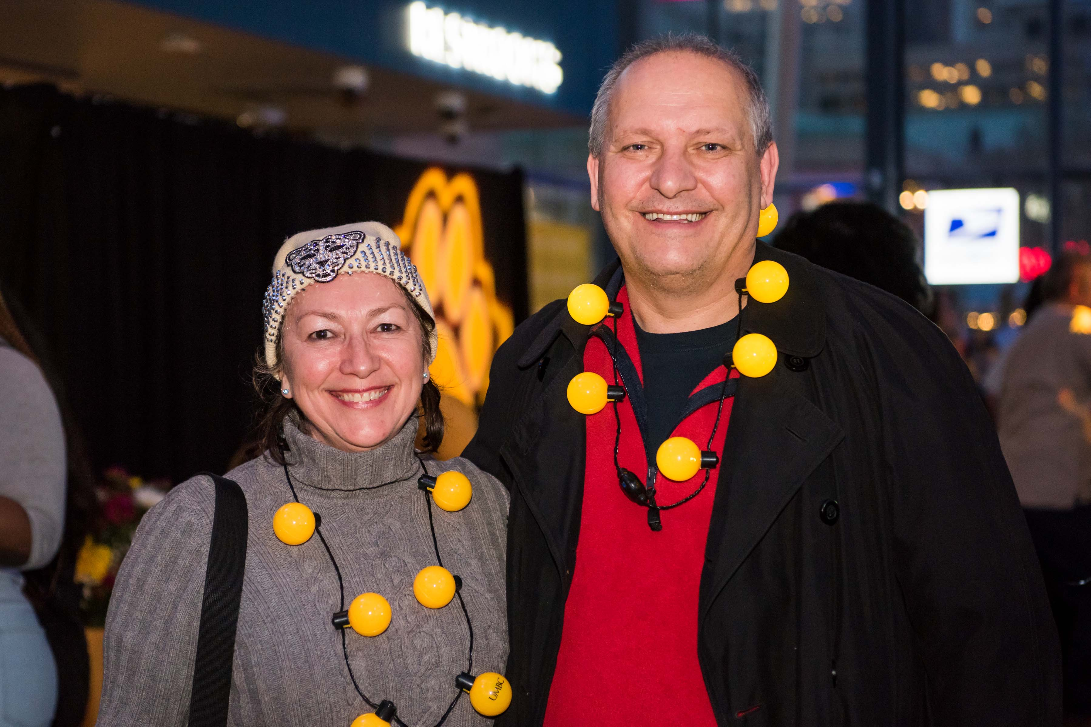 Two people pose together at light city alumni reception