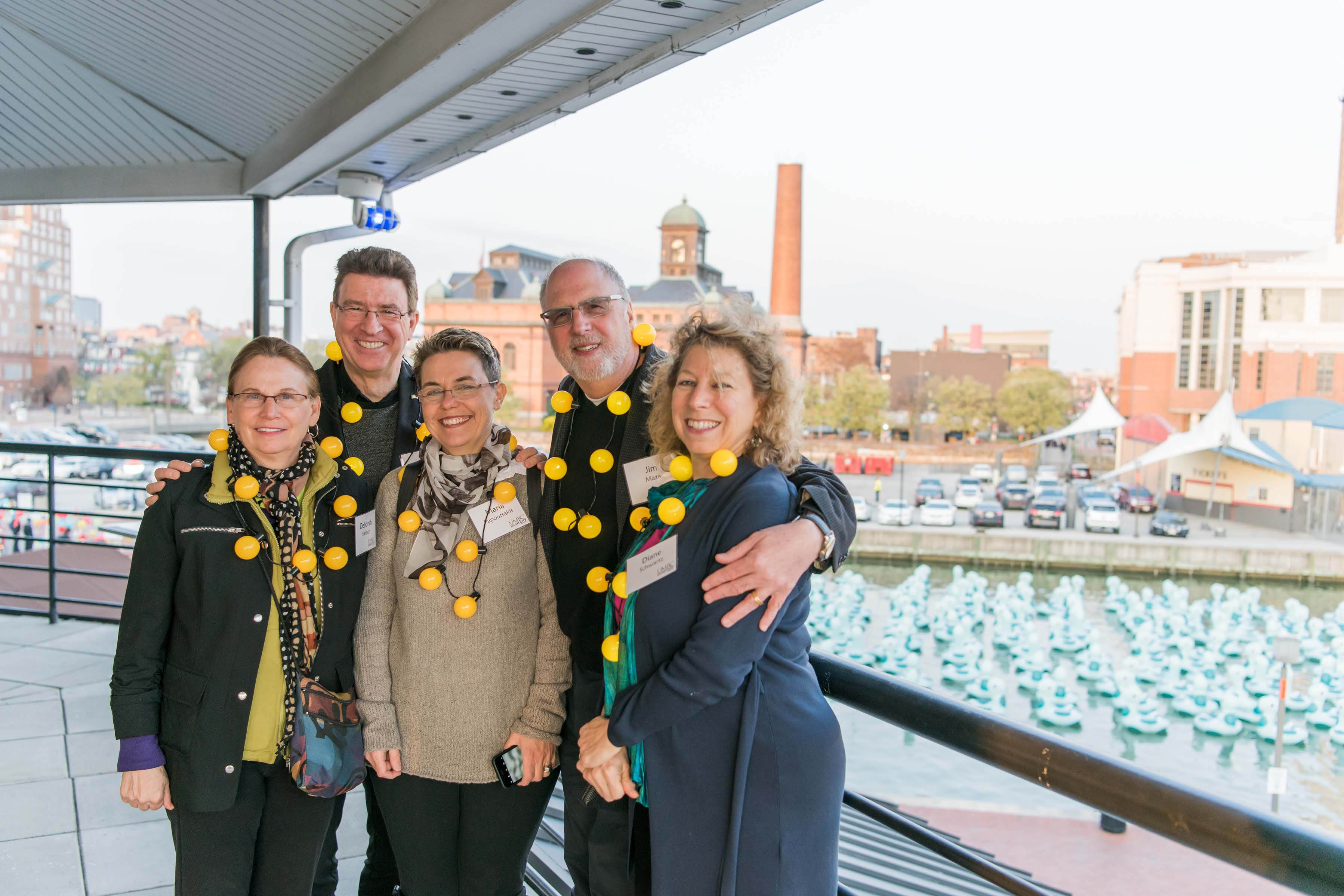 Group of five pose outside at Pier 5 reception