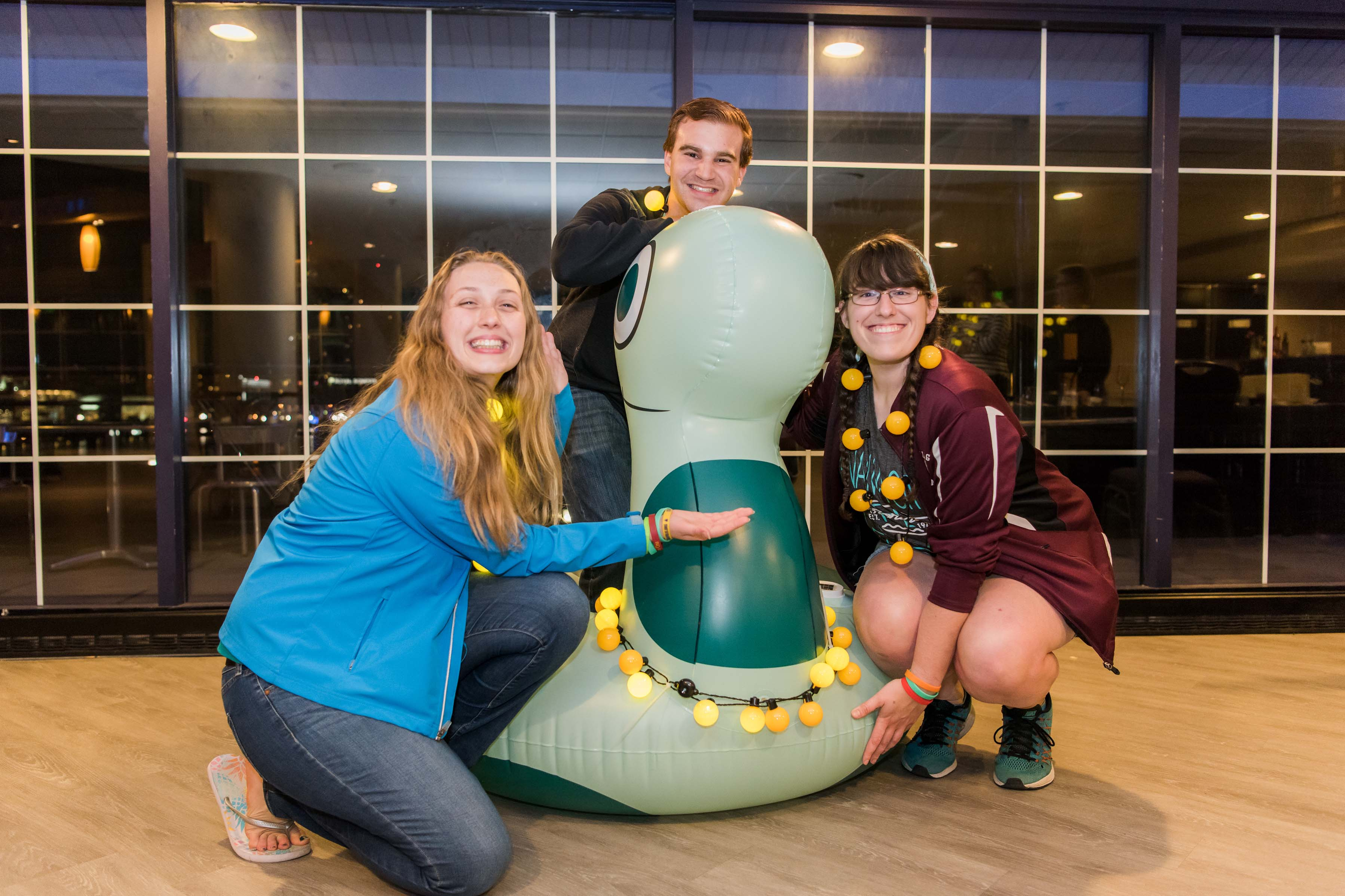 Katelyn, Ally, and other student pose with blow up animal
