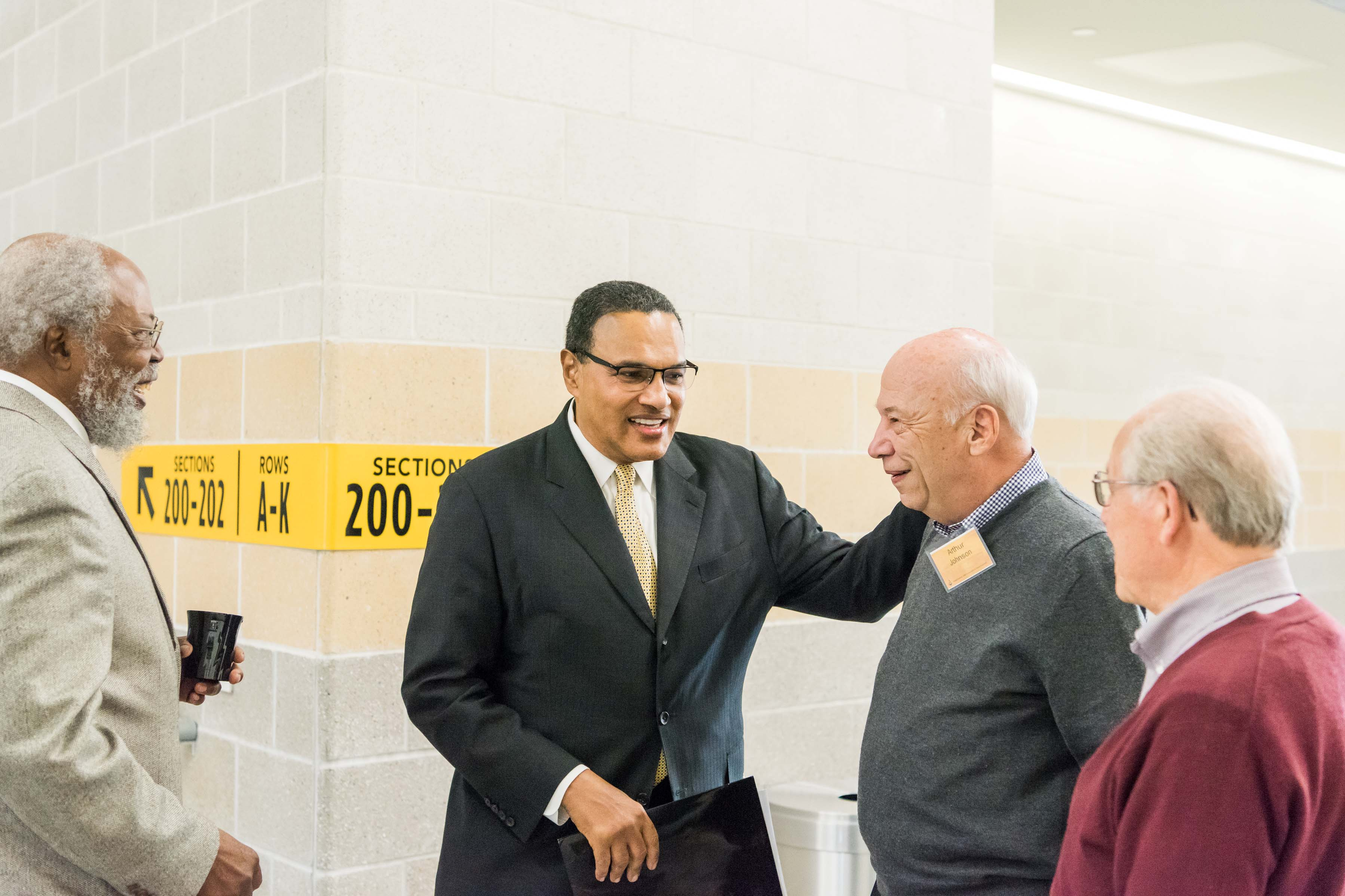 Hrabowski smiles and talks with people at Wisdom Institute lunch