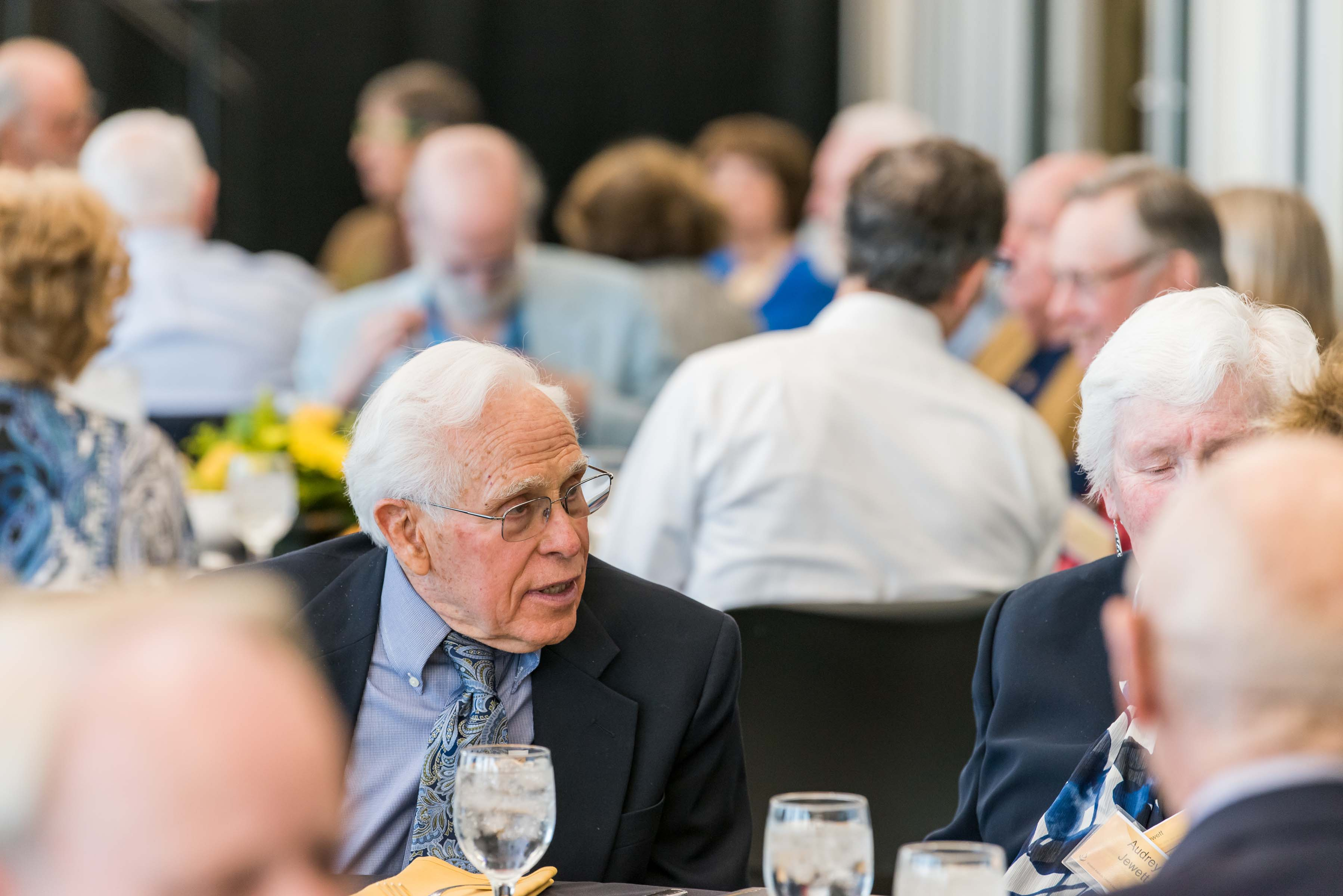 men talking at Wisdom Institute lunch
