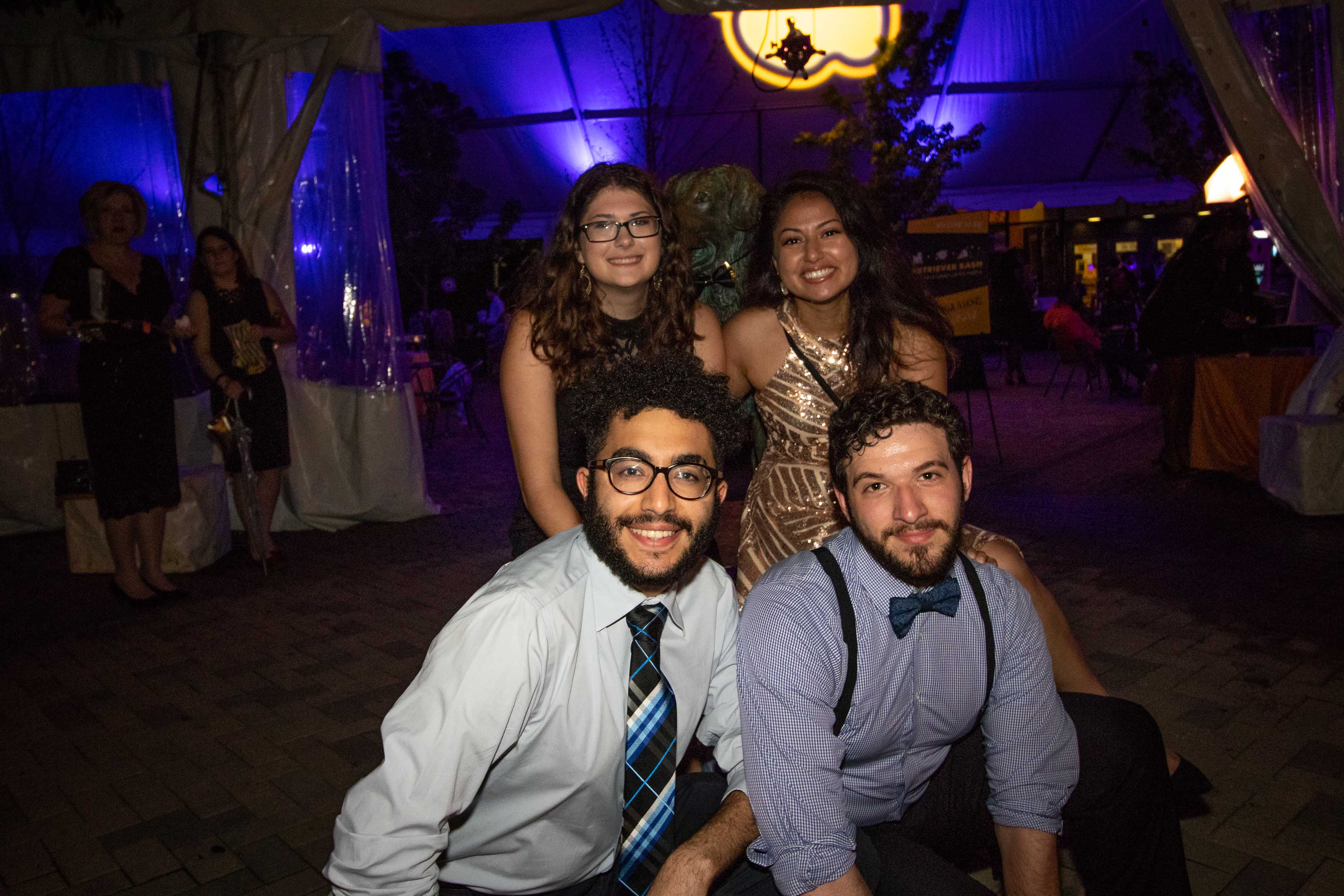 Four grads dressed up for Grad dance