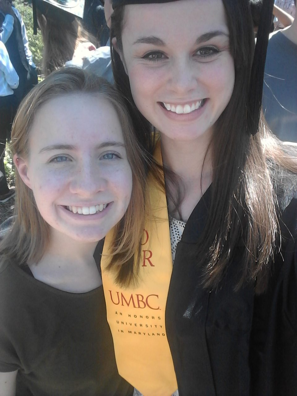 Graduating student poses with Cayla