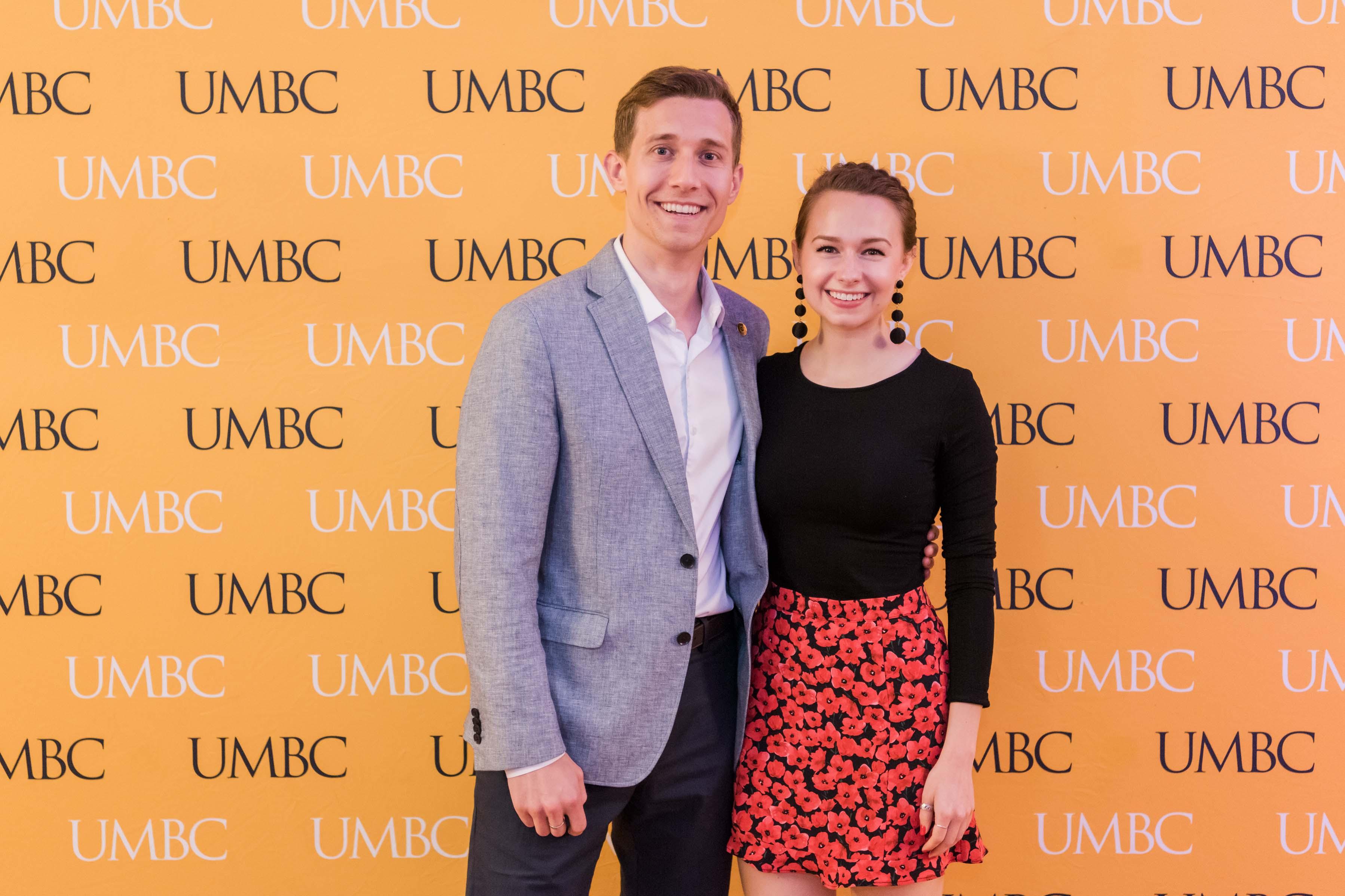 Couple pose for UMBC wine tasting