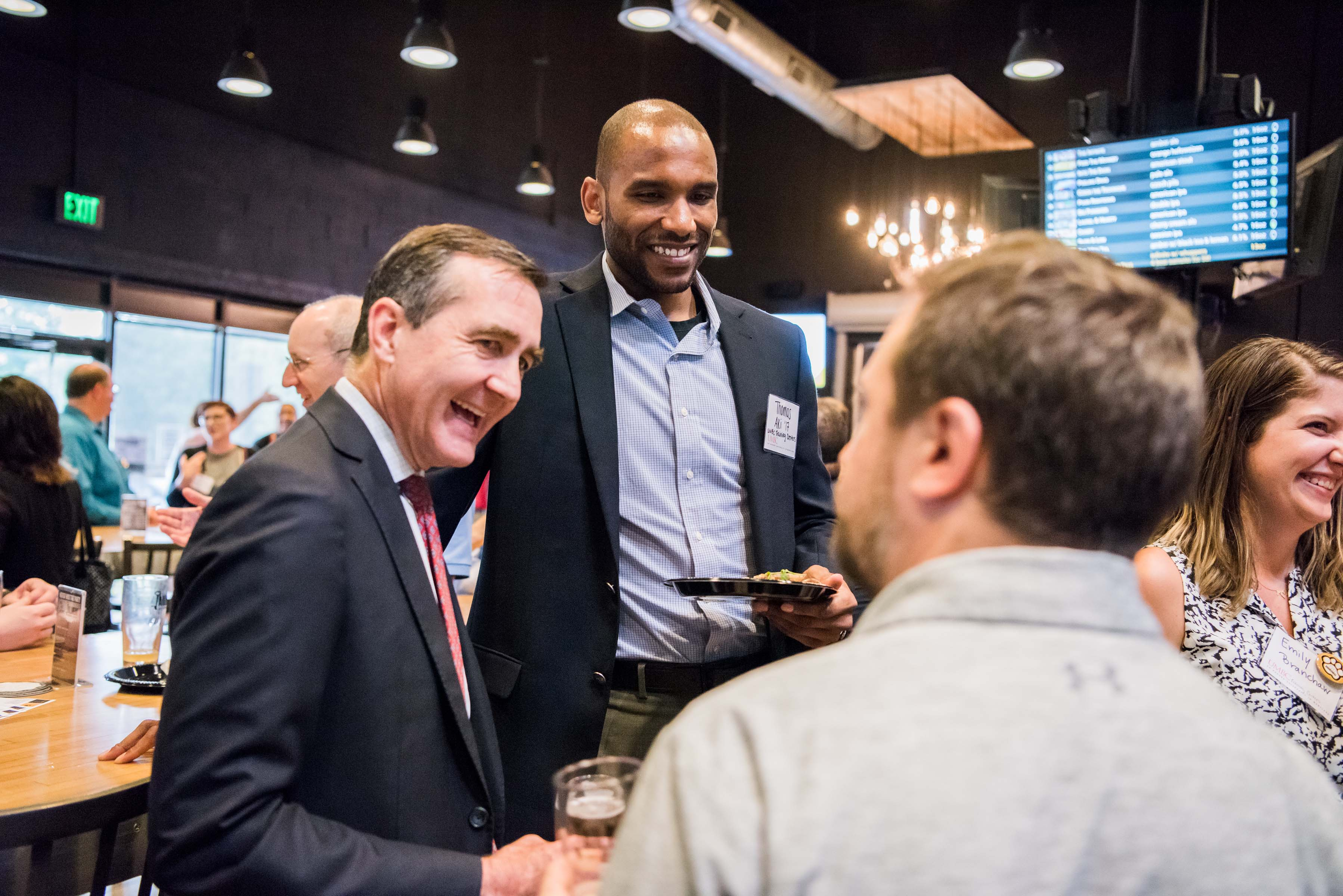 Greg simmons and others laughing at ITE happy hour