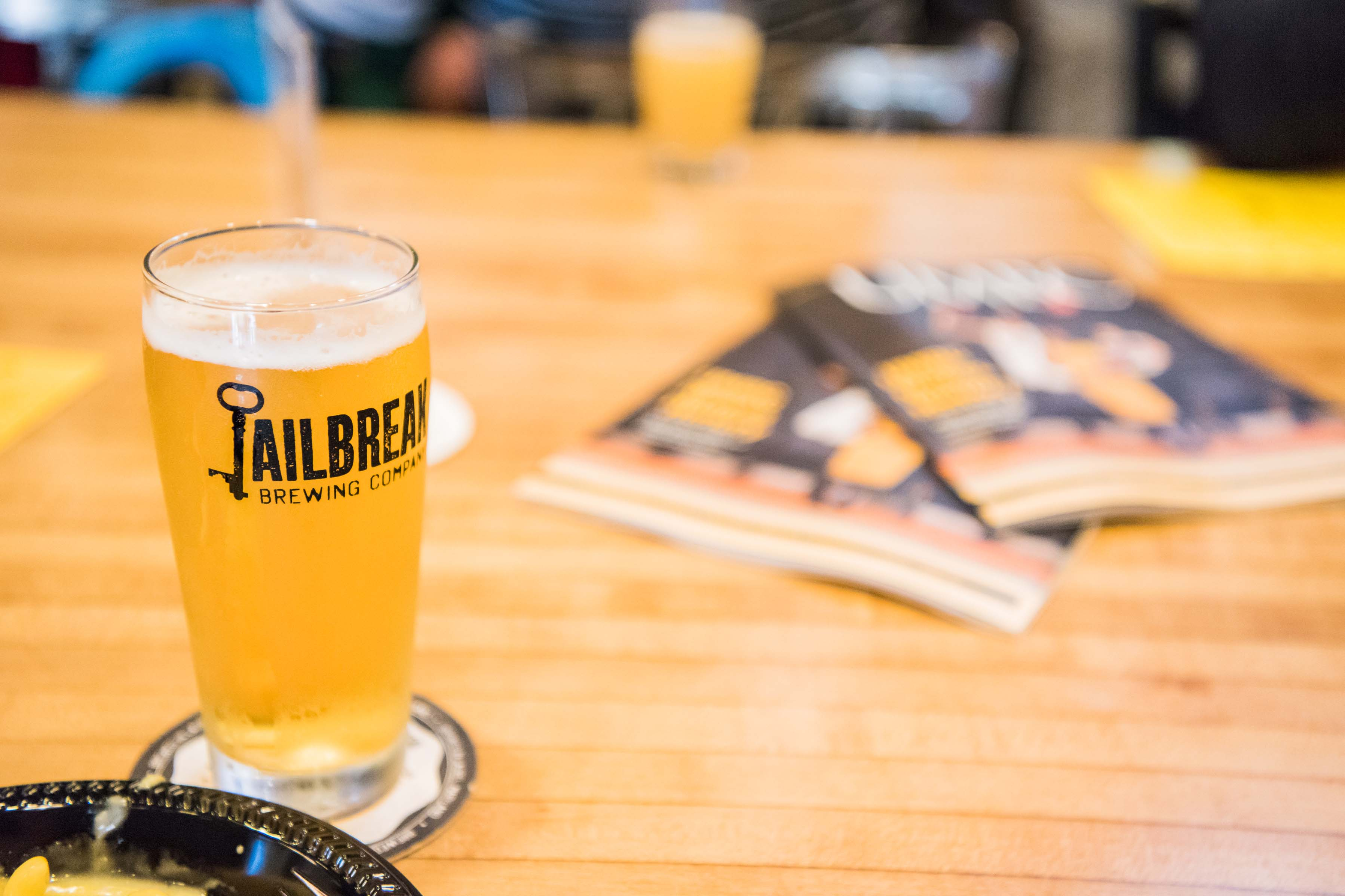 Jailbreak brewing company glass with beer on table