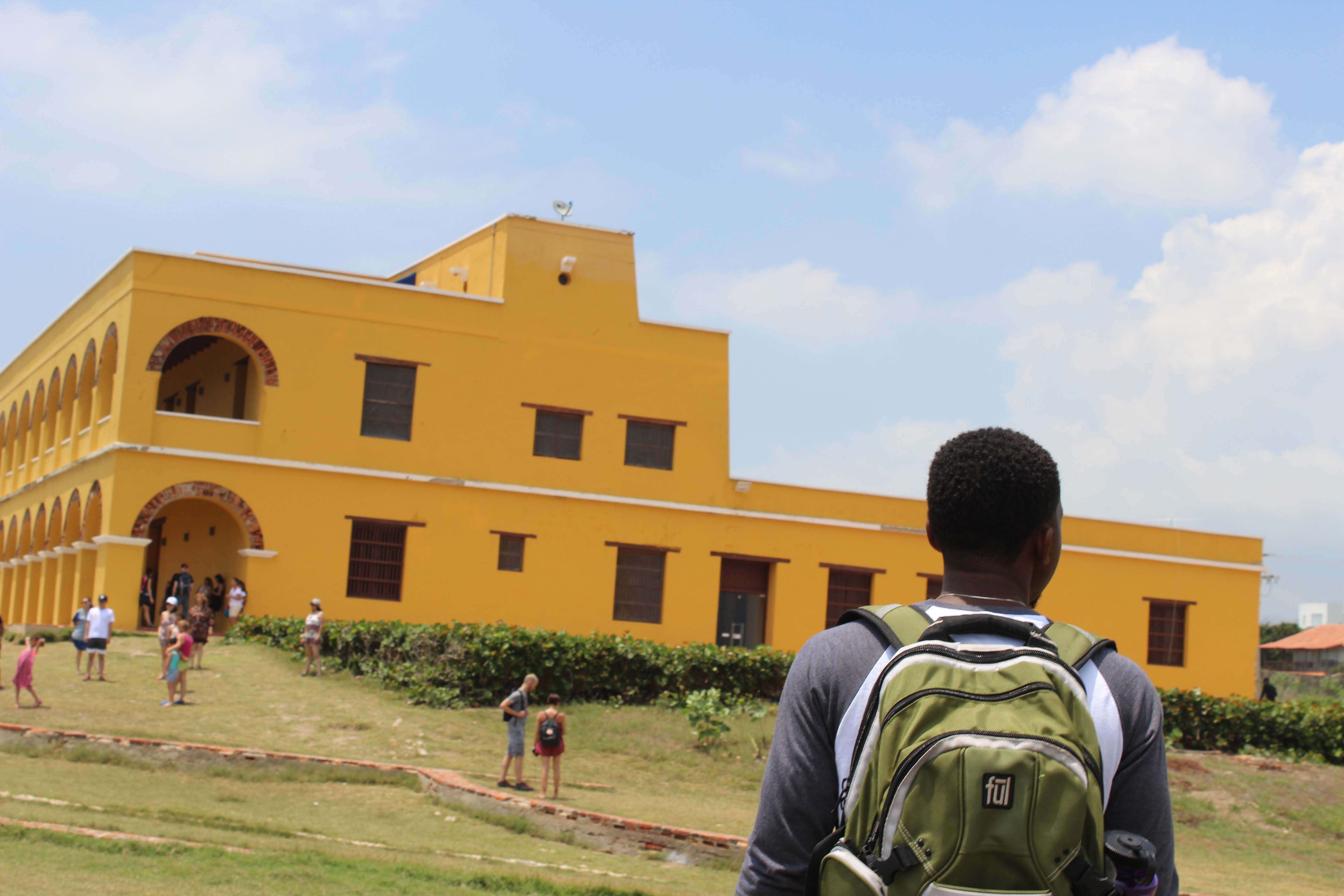Student approaches a foreign building