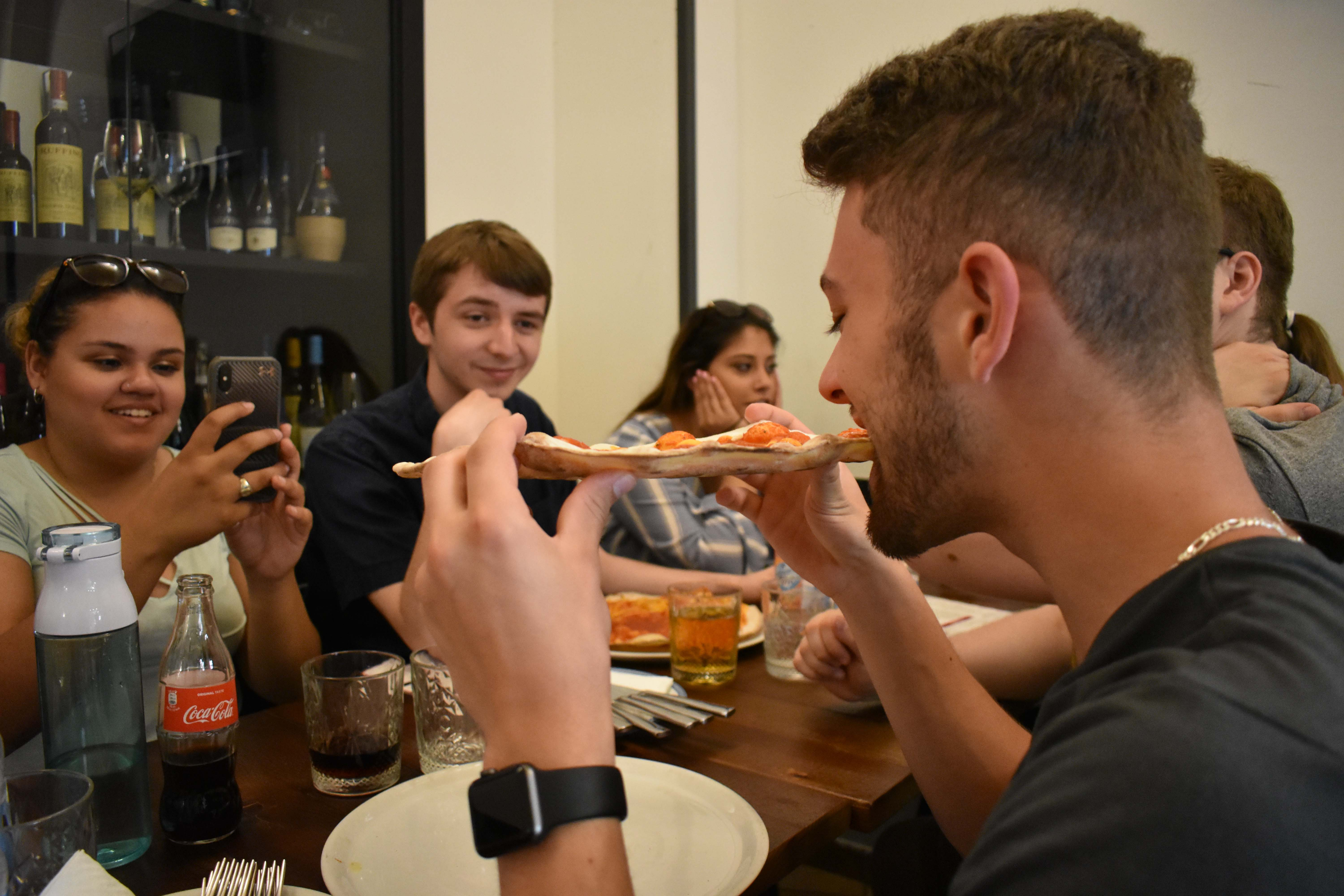 Students share a meal abroad