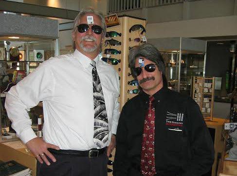 2 Men trying on sunglasses