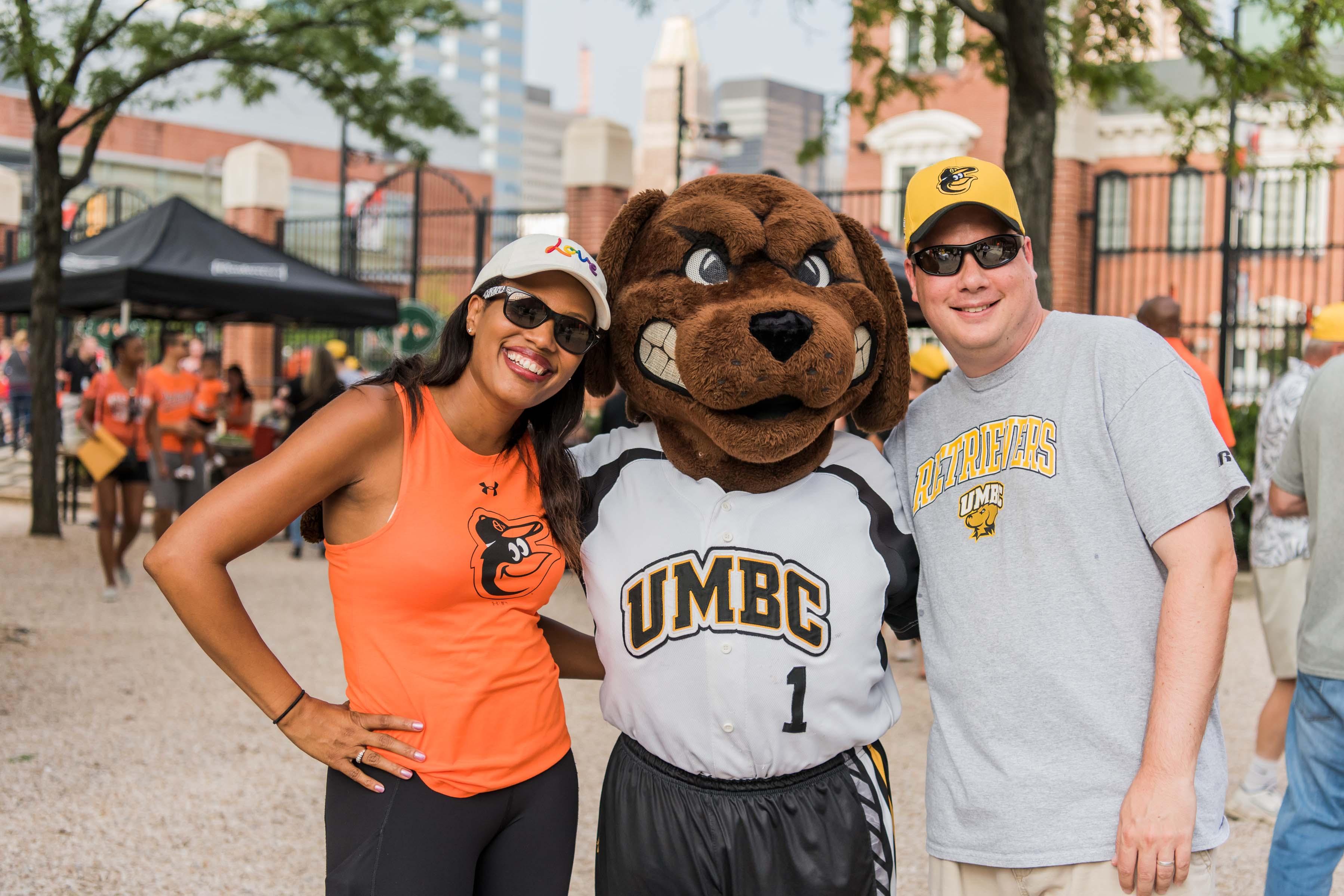 UMBC mascot posing with fans