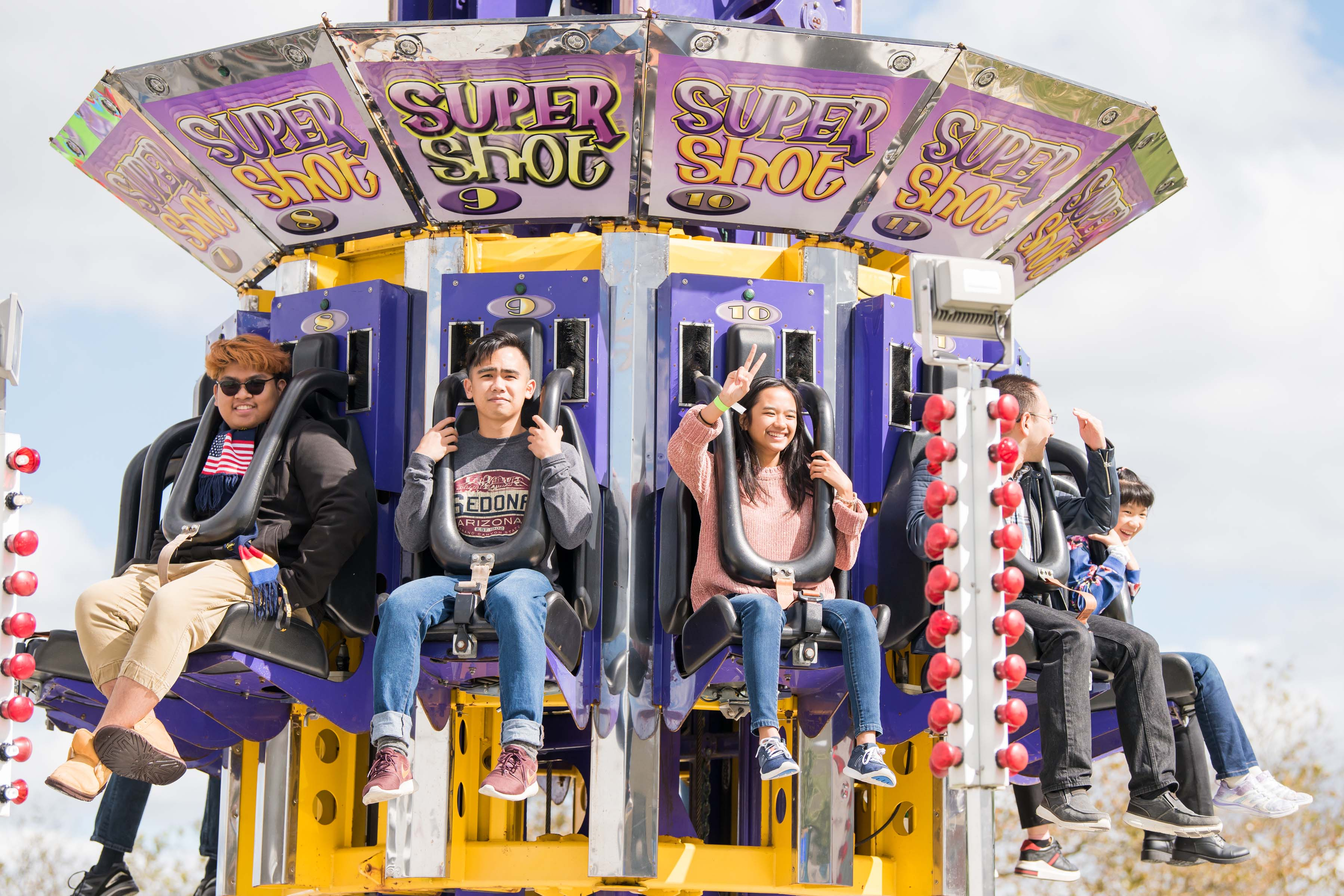 Students pose on super shot ride