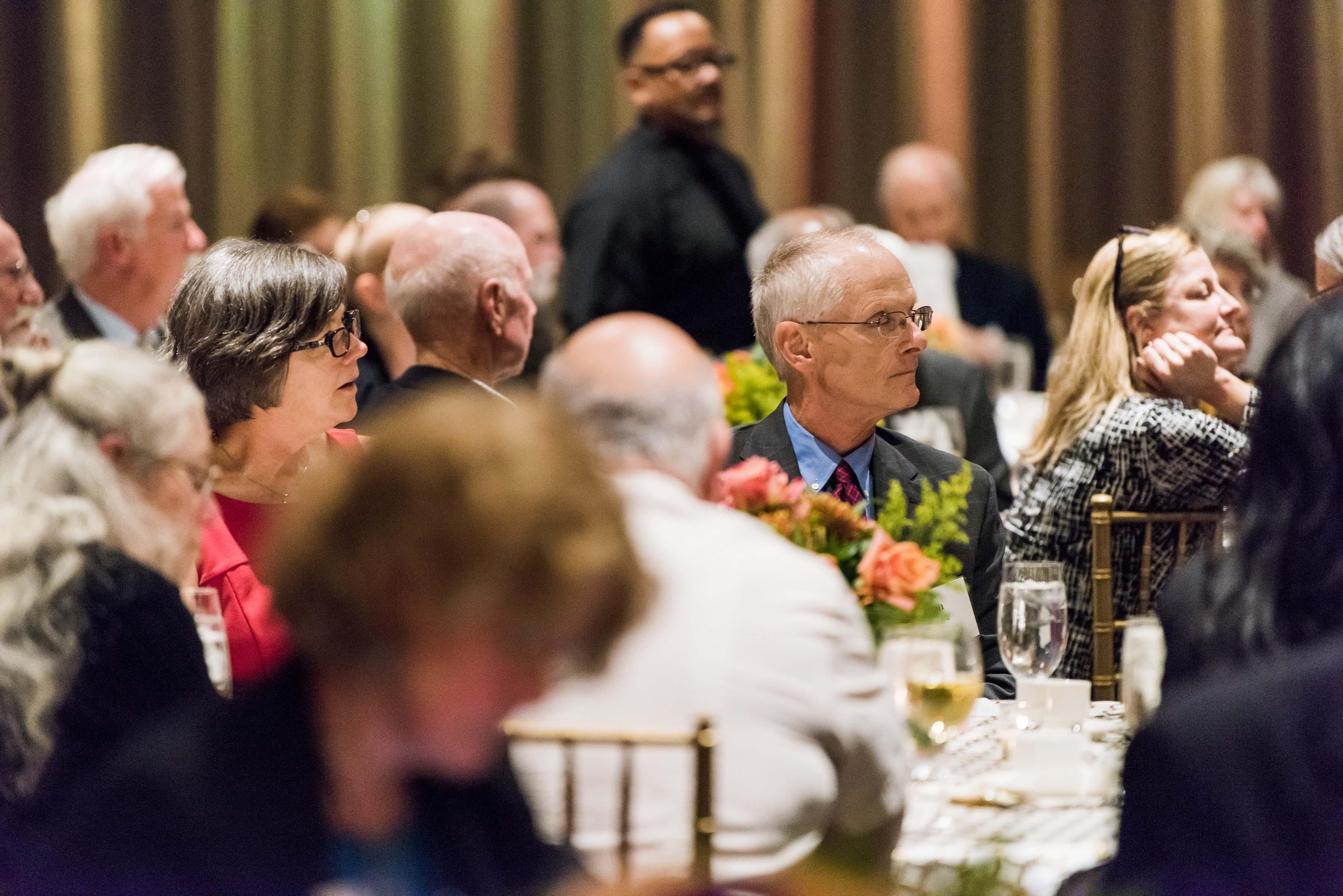 Guests listen to Dr. Laviks talk