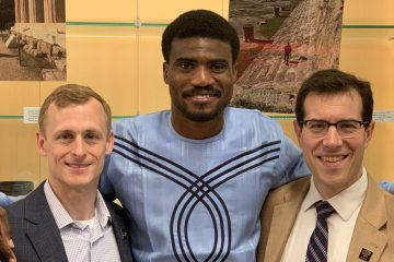 Damian Doyle, right, and Ray Soellner, left, the associate director of telecommunications, and Tobi Odunsi, middle, a master's student in cyber security. Photo courtesy of Tobi Odunsi.