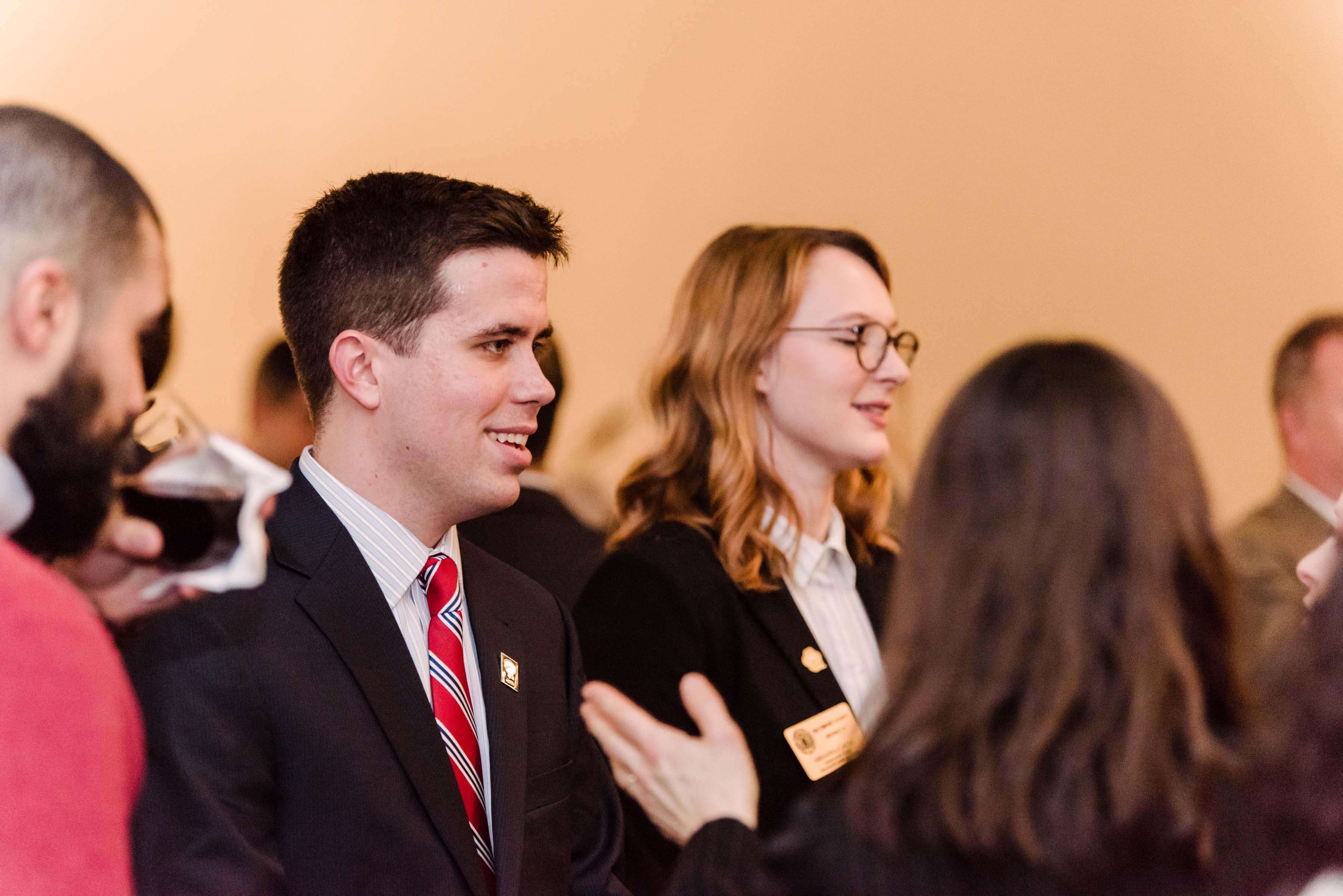 People in conversation at Annapolis alumni reception