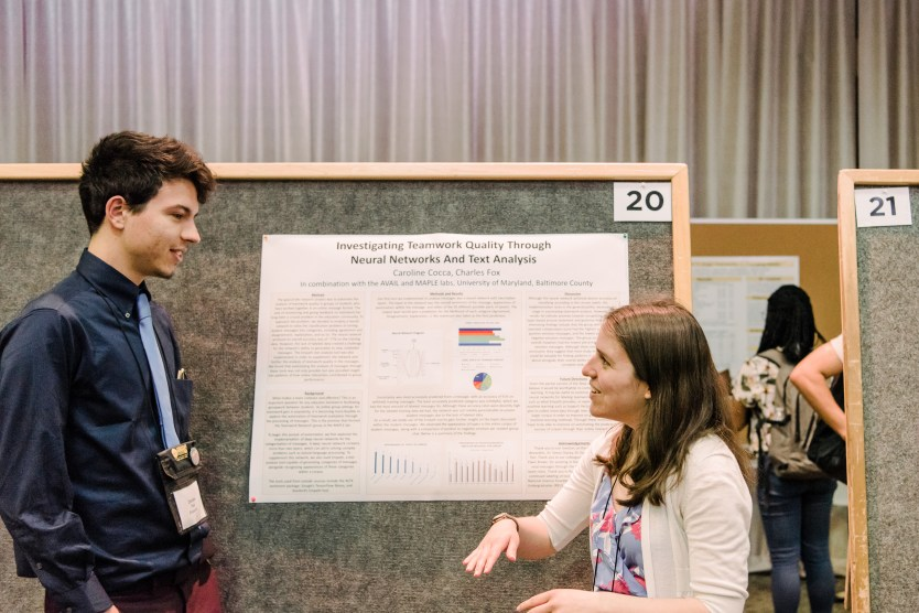 Students present their poster presentation and hone their talking points throughout the day.