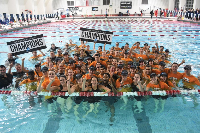The teams celebrate their America East championships victory with a commemorative jump into the pool. Photo by Colleen Humel.