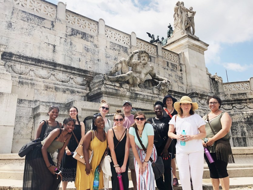 Students enjoy the sunshine on a summer trip to Italy.
