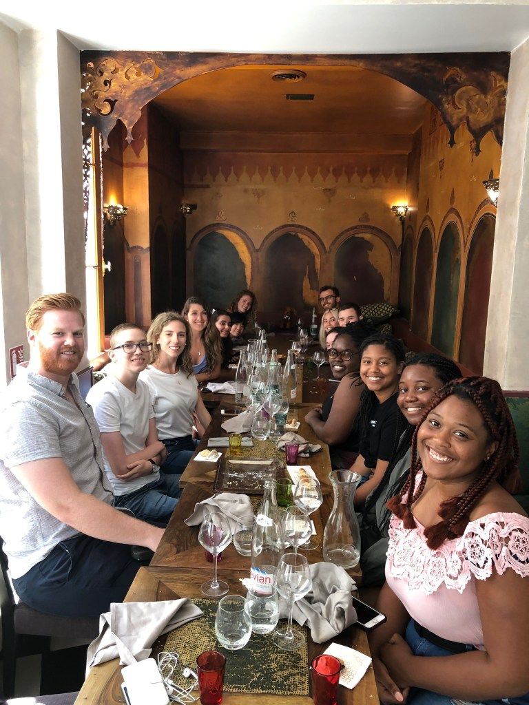 UMBC students enjoy a group dinner in France during a summer abroad trip.