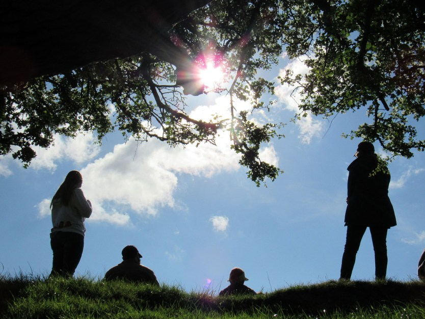 UMBC students enjoy the sunshine in Wales on a study abroad trip.