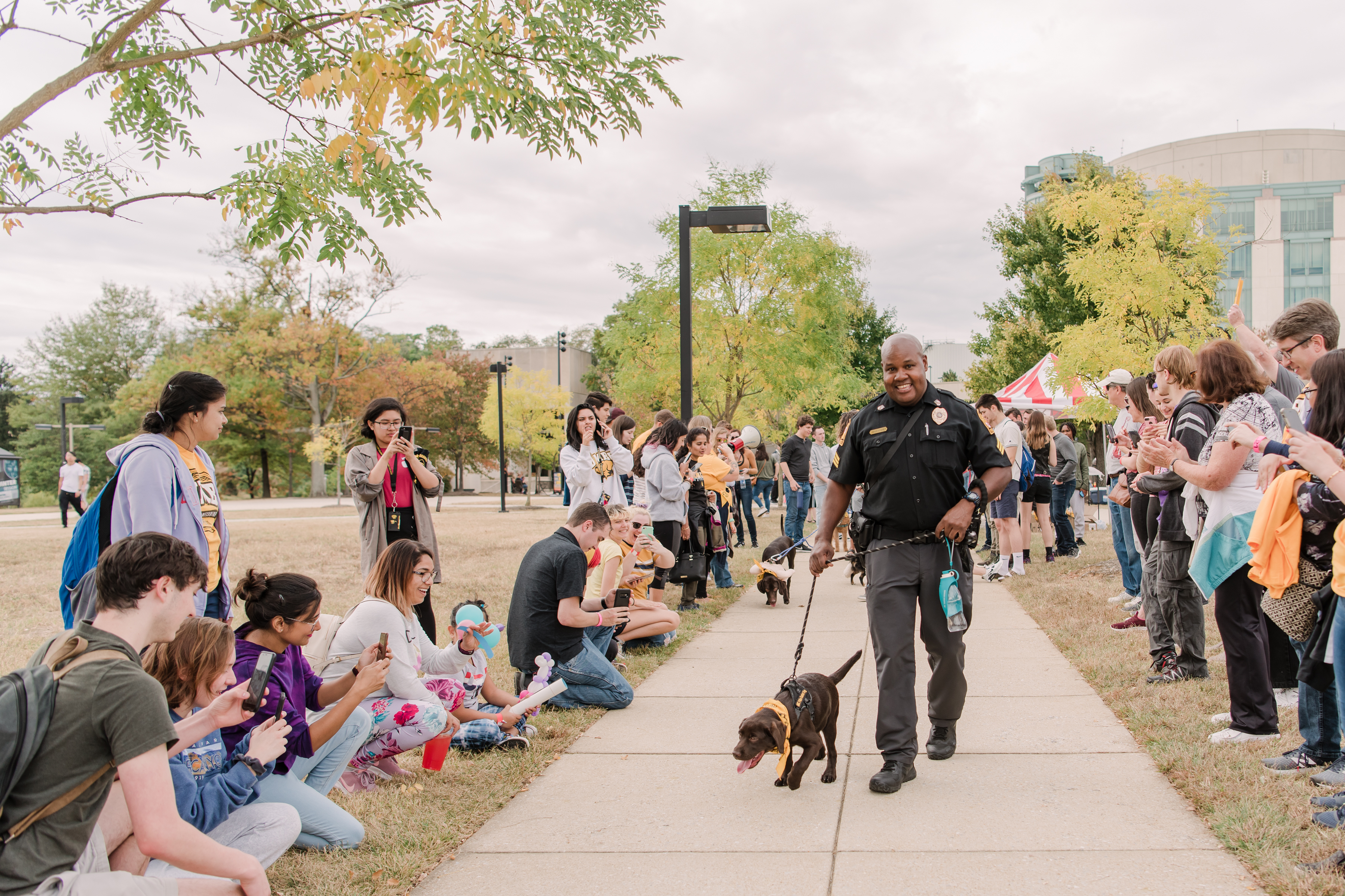 Officer Cheatum and Chip at puppy parade