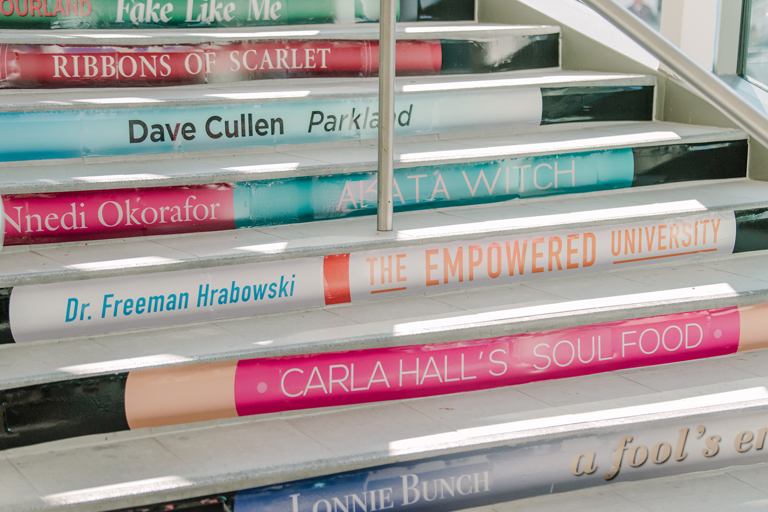 Steps with colorful renditions of book spines