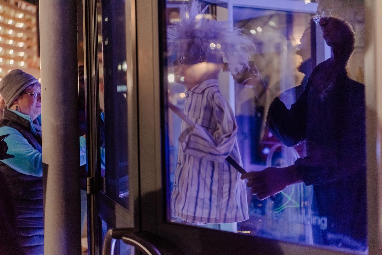 puppet show through a window