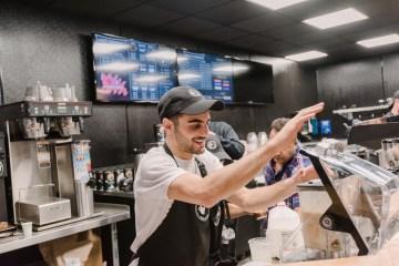 Co-founder of Oca Mocha Michael Berardi makes a coffee