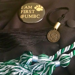 pin, graduation tassel and cord
